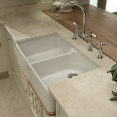 Butler sink creating the traditional look with quartz worktop and Oak base