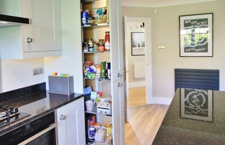 Grey kitchen design with pull out larder Chelmsford, Essex
